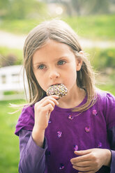 Portrait of little girl testing cake pop - SARF000529