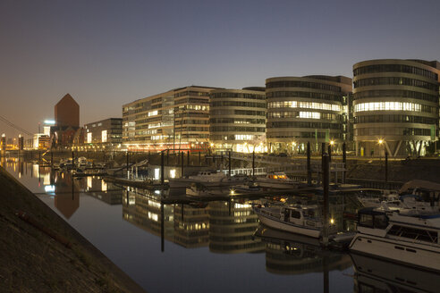 Germany, North Rhine-Westphalia, Duisburg, Inner harbour and office buildings, Five Boats, by night - WIF000609