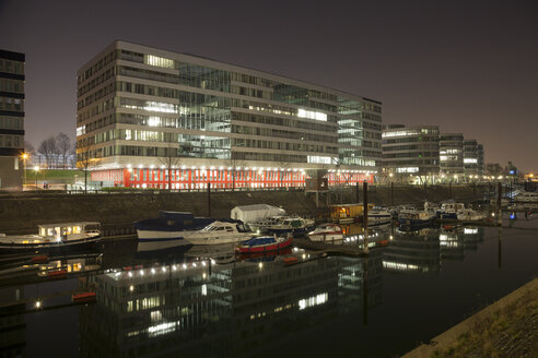 Germany, North Rhine-Westphalia, Duisburg, Hitachi Power Office and Marina by night - WIF000611