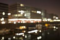 Germany, North Rhine-Westphalia, Duisburg, Inner harbour by night, blurred - WIF000614
