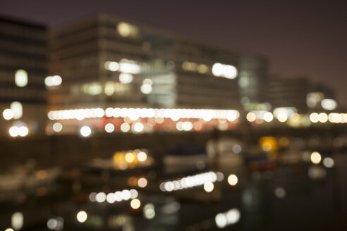 Germany, North Rhine-Westphalia, Duisburg, Inner harbour by night, blurred - WIF000614