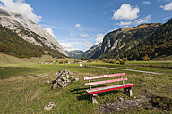 Austria, Tyrol, Alpine Park Karwendel, Wooden bench with the Engalm in the background - RJF000113