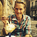 Belgium, Flanders, Bruges, woman enjoying a Advokaat sundae with whipped cream - GWF002735