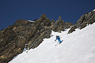 Austria, East Tyrol, Defereggental, Man telemark skiing - FF001404