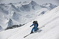 Austria, East Tyrol, Defereggental, Man telemark skiing - FF001412