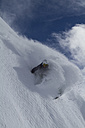 Austria, East Tyrol, Defereggental, Man backcountry skiing - FF001413