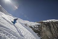 Italy, Dolomites, Val Gardena, Man telemark skiing - FF001396