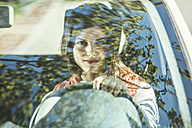 Spain, Barcelona, Young woman in car - EBSF000224