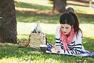Spain, Barcelona, Student learning in park - EBSF000241