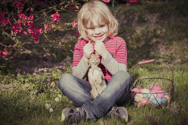 Boy with Easter bunny in garden - MJF000979
