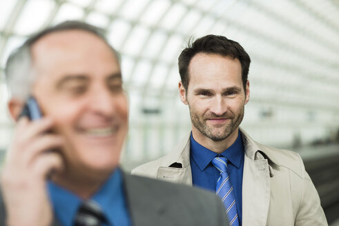 Portrait of two confident businessmen - UUF000384