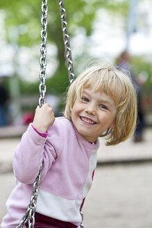 Portrait of smiling little girl on swing - JFEF000343