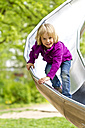 Portrait of smiling little girl on chute - JFEF000347