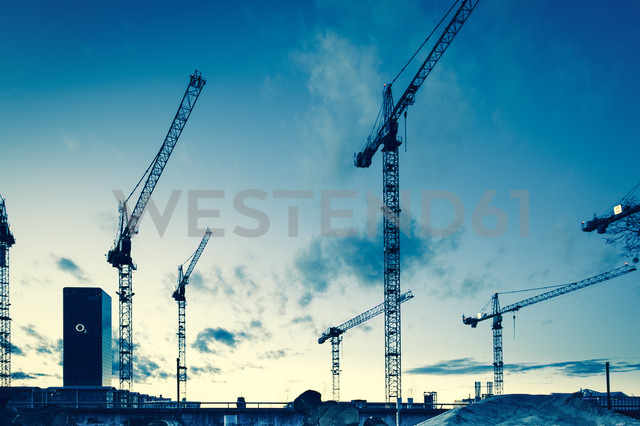 Germany, Bavaria, Munich, Cranes against blue sky - FC000151