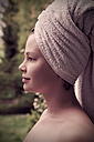 Portrait of smiling woman with towel on her head - HOHF000754