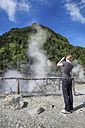 Portugal, Azores, Sao Miguel, Furnas, Woman taking picture of Caldeiras - ONF000501