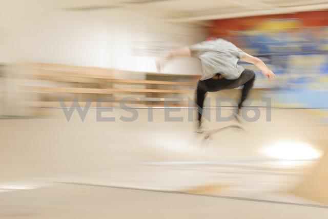 Skate boarder making Kickflip at skateboard ground - LAF000741