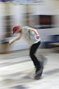 Skate boarder making Ollie at skateboard ground - LAF000745