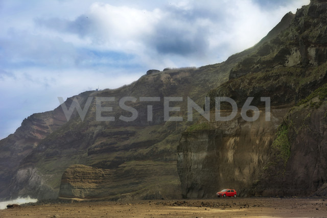 Portugal, Azores,Sao Miguel, Red car at  Piscina naturale di Ferreira - ONF000463