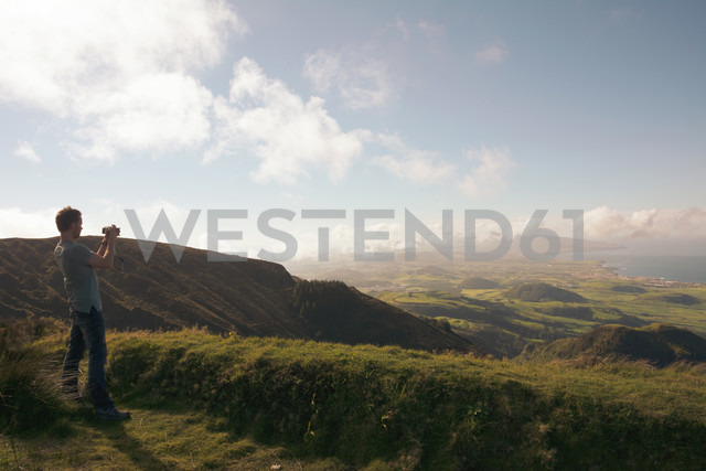 Portugal, Azores,Sao Miguel, Tourist capturing view - ONF000486