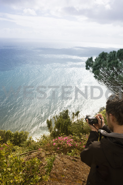 Portugal, Azores,Sao Miguel, Tourist capturing view - ONF000450