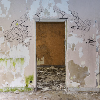 Portugal, Azores, San Miguel, doorframe and drawings on wall in empty hotel ruin - ON000477