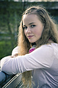 Portrait of female teenager with headphones - SARF000553