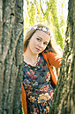 Portrait of female teenager wearing flowers - SARF000567