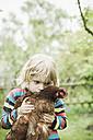 Portrait of little boy with chicken - MJF001104