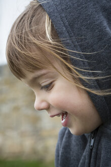 Portrait of laughing little girl wearing hooded jacket - LVF001153