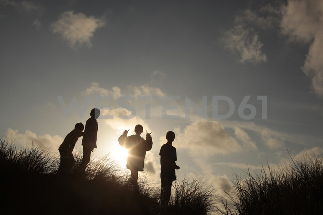 Norway, Rogaland, playing children in backlight - TM000018