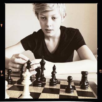 Young boy playing chess, Hamburg, Germany - MSF003869