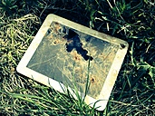 Broken tablet-PC in the meadow - LAF000735
