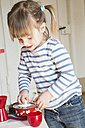 Little girl playing with children's kitchen - LVF001174
