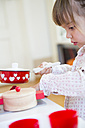 Little girl playing with children's kitchen, partial view - LVF001181