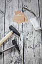 Hammer, nails, band-aids, bandage and scissors on grey wood, elevated view - SBDF000802