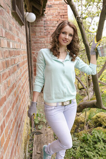 Portrait of woman with gardening gloves - VTF000221