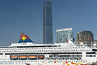 China, Hong Kong, Kowloon, ship at Victoria Harbour with ICC tower and other skyscrapers in the background - SH001234