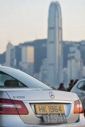 China, Hong Kong, Kowloon, back of a Mercedes in downtown with skyscrapers in the background - SH001257