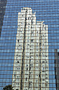 China, Hong Kong, reflections of a skyscraper in the front of a business building in downtown city centre - SHF001266