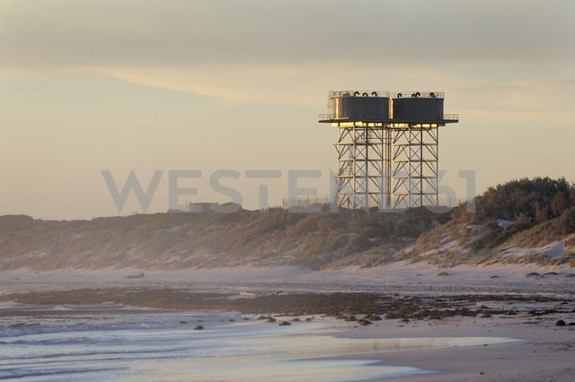 Australia, Western Australia, Lancelin, view to water towers behind beach dunes - MIZ000467