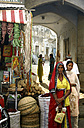 India, Rajasthan, two women standing beside market stall - FC000181