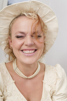 Portrait of laughing bride wearing hat - ECF000618