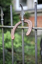Germany, Bavaria, Old horseshoe on fence - VTF000222