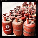 Nepal, Langtang Region, gas tank in front of house - MMO000229