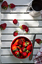 Bowl of strawberries, knife and jar on white wood, elevated view - LVF001243