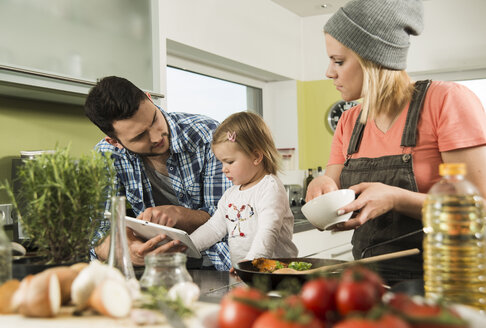 Family cooking in kitchen at home - UUF000472