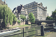 France, Alsace, Strasbourg, L'ill River, View of waterfront with boat - SBD000909