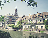 France, Alsace, Strasbourg, L'ill River, View of waterfront and Strasbourg Cathedral tower - SBDF000910