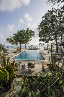 Indonesia, Riau Islands, Bintan, Nikoi Island, Sun loungers at hotel pool - THAF000346